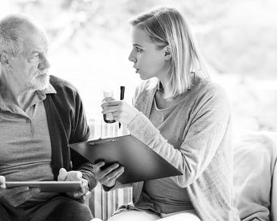 caregiver talking to senior man